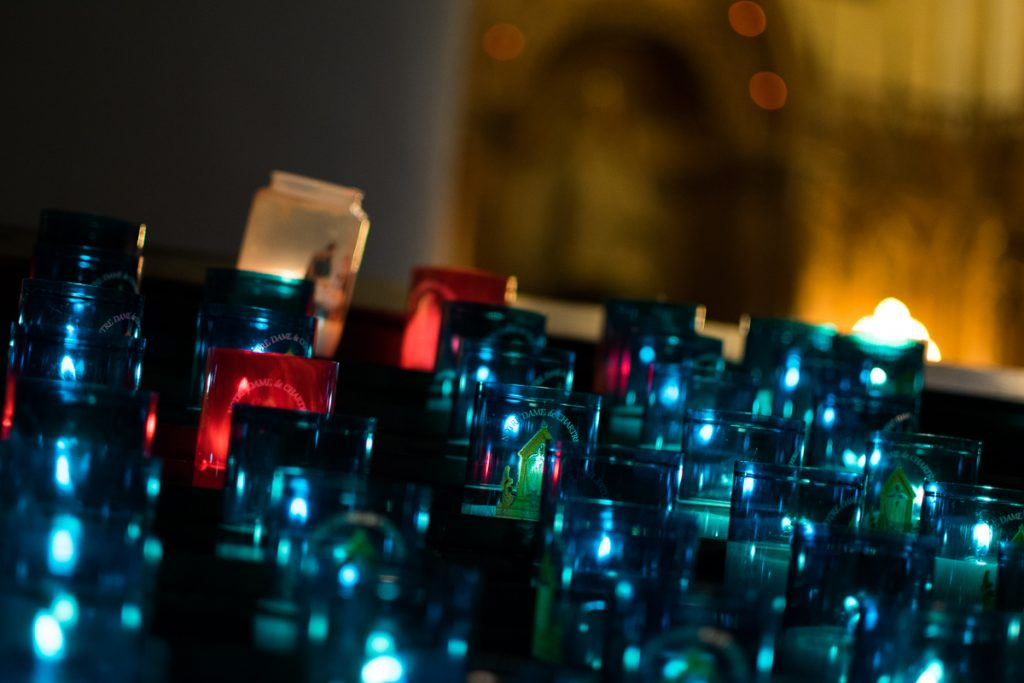 Candles lit by the faithful